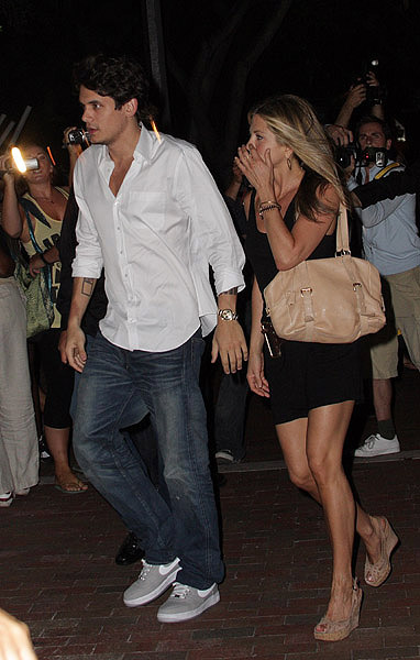 Jennifer Aniston (R) and John Mayer (L) arrive together to the ""